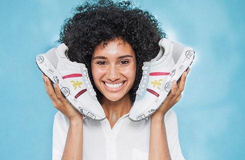 Woman holding Premiata Shoes